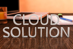 Cloud Solution. Letters on wooden desk with laptop computer and a notebook. 3d render illustration Royalty Free Stock Photo