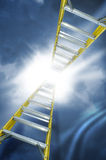 Cloud storage. Two yellow ladders reach into a sky and disappear into a bright light.  Concept for reaching a goal or reaching the top.  Abstract for cloud Stock Image