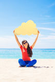 Cloud storage concept. Woman holding paper cloud icon. On the bea Stock Photos