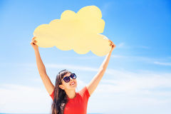 Cloud storage concept. Woman holding paper cloud icon. On the bea Stock Images