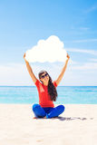 Cloud storage concept. Woman holding paper cloud icon. On the bea Stock Image