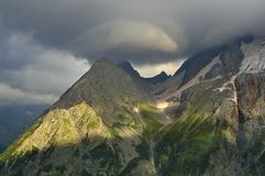 Cloud and summits. This is somber cloud in Caucasus mountains in evening Royalty Free Stock Image