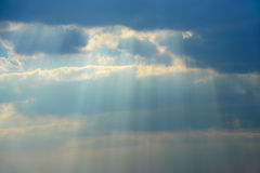 Cloud with sun beams Royalty Free Stock Image