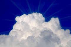 Cloud with Sun Rays in Blue Sky Royalty Free Stock Photo