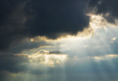 Cloud with sun rays Stock Images