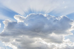 Cloud with sunbeams Royalty Free Stock Image