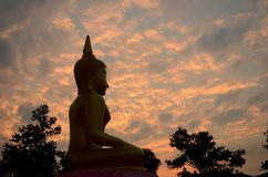 Cloud sunset and buddha statue Stock Photography