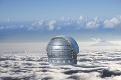 Cloud surrounded observatory. Cloud surrounded dome of an observatory. The background shows a mountain peeking out of the clouds Royalty Free Stock Photos