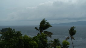 Cloud sweeps over the ocean during typhoon Mitag - Philippines. Clouds rolling in during tropical storm Mitag stock video