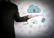 Cloud technology concep. Successful businessman at the light background.  royalty free stock photography