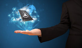 Cloud technology in the hand of a businessman. Businessman presenting cloud technology in his palm Stock Images