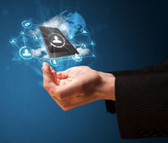 Cloud technology in the hand of a businessman. Businessman presenting cloud technology in his palm Stock Photography