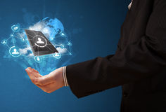 Cloud technology in the hand of a businessman Stock Photo