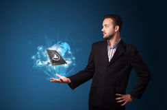 Cloud technology in the hand of a businessman. Young businessman holding cloud technology in his hand Royalty Free Stock Photo