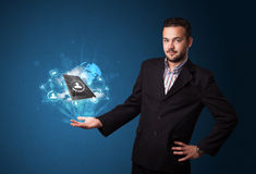 Cloud technology in the hand of a businessman. Young businessman holding cloud technology in his hand Royalty Free Stock Photos