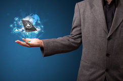 Cloud technology in the hand of a businessman. Young businessman holding cloud technology in his hand Royalty Free Stock Images