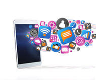Cloud of technology icone going out a tablet Royalty Free Stock Photos