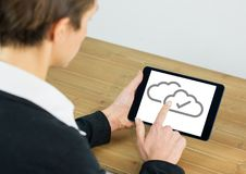 Cloud tick icons on tablet with hand Royalty Free Stock Photos