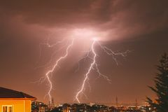 Lightning strike in the city. Cloud to ground lightning strike in the city Stock Images