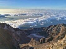 Cloud under the blue sky on mountain Rinjani summit. Stock Photography