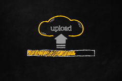 Cloud Upload concept. Cloud upload progress bar with copyspace. Uploading data concept with a progress bar on a blackboard. Hand drawn cloud with symbol and text Royalty Free Stock Photography