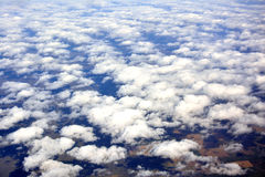 Cloud view from airplane in sky. View of cloud from airplane in sky, shown as travel concept and landscape view of sky Royalty Free Stock Images