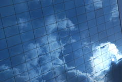 Cloud Wall. Reflection of the clouds and sun Royalty Free Stock Image