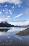 Cloud wisps in the Chilkat River Royalty Free Stock Images