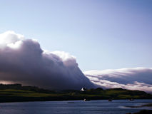 Cloudbank. A huge bank of low clouds rolls over the Scottish coast Stock Photography