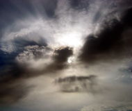 Cloudburst. The sun and the clouds playing games royalty free stock image