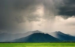 Cloudburst in mountains royalty free stock photography