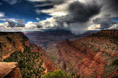 Cloudburst over Grand Canyon. A vivid, colorful landscape that includes a dramatic local cloudburst and rain shower over the Grand Canyon Royalty Free Stock Photos