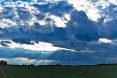 Cloudburst and sun rays over Sprotbrough Fields, South Yorkshire. Taken to capture a simultaneous cloud burst and sunstreak across Sprotbrough fields in South Royalty Free Stock Image