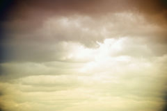 Cloudburst. Sunlight breaks between rain clouds and clouded clouds Royalty Free Stock Photo