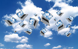 Cloudcomputing. Many Laptops are flying with clouds Royalty Free Stock Images