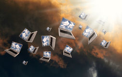 Cloudcomputing. Many Laptops are flying with clouds Royalty Free Stock Photos