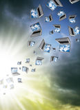 Cloudcomputing. Many Laptops are flying with clouds Royalty Free Stock Photo