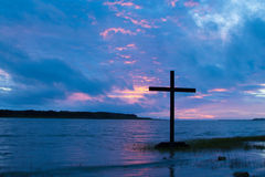 Clouded Cross Sunset Stock Photo