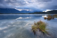 Clouded dusk over Barmsee lake with view on Karwendel mountains Stock Images