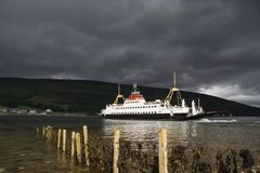 Clouded ferry. Heavy sky over a car ferry on the Kyles of Bute, Scotland stock photography