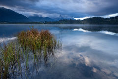 Clouded morning on Barmsee lake in Alps Royalty Free Stock Photo