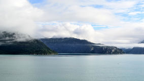 Clouded Mountains. Cloud covering mountains in Glacier Bay National Park, Alaska Royalty Free Stock Images