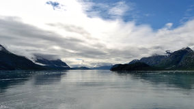 Clouded Mountains. Glacier Bay vista with clouds surrounding mountains Stock Photo