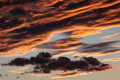 Cloudy sky zoomed details at sunset stock photos