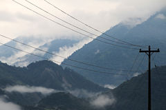 Cloudforest Ecuador mountains with phone mast. In front. On the way down to the amazonas basin stock image