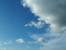 Clouding Over. Lush blue sky with looming clouds Royalty Free Stock Image
