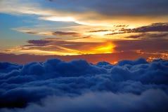 cloudlandsolnedgång Arkivbild