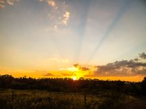 Sunset seen from a farm Royalty Free Stock Photo