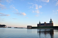 Cloudless weather and castle seen from the shore of the lake on the island of Kalmar stock images