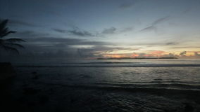 Cloudly Maldivian sunset. Beautiful teal and orange ocean sunset on maldivian island vith small island with palms and trees in far. Panoramic camera view from stock video